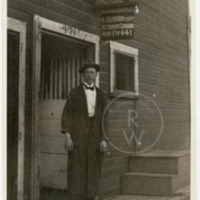 Harry Colebourn standing outside his veterinary practice