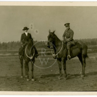 Harry  Colebourn on horseback with friend